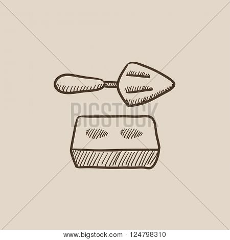 Spatula with brick sketch icon.