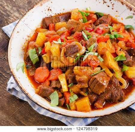 Beef Stew With Vegetables On A Wooden Table.