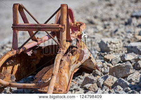 Discarded wheelbarrow  rusting after years of service