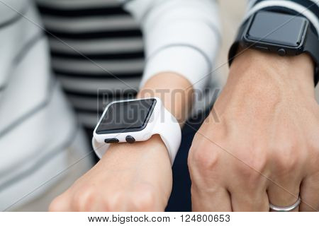 Couple using smart watch together