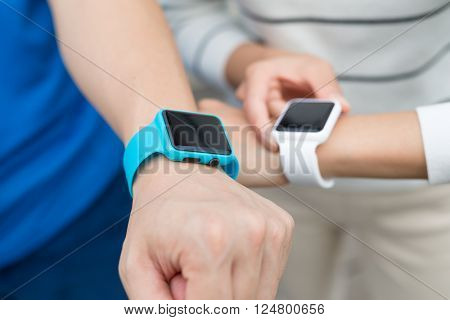 Two people using smart watch together