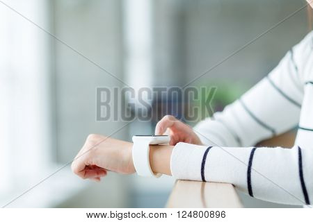 Woman use of smartwatch