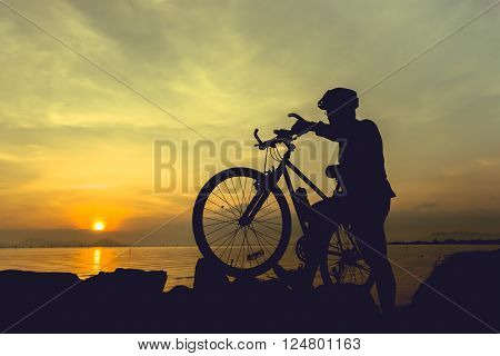 Healthy Lifestyle. Silhouette Of Bicyclist Standing With Bike At Seaside. Outdoors.