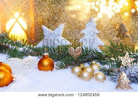 Christmas balls with fir and snow on windows