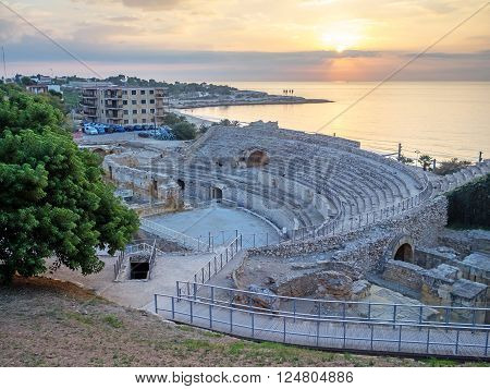 Roman amphitheater and Mediterranean Sea at sunset in Tarragona Catalonia Spain ** Note: Visible grain at 100%, best at smaller sizes