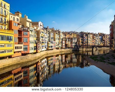 Colorful houses reflected in water Girona Catalonia Spain