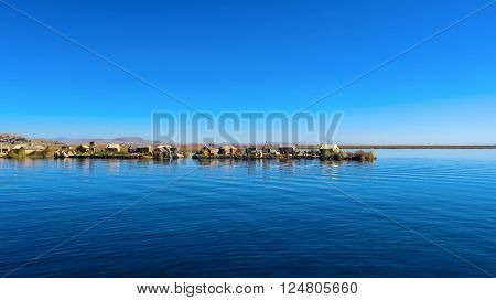 Lake Titicaca floating islands with blue lake water in Peru
