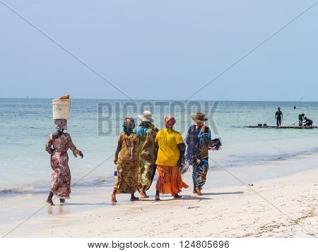 PAJE, ZANZIBAR - MARCH 30, 2016: Local women going fishing on a beach in Zanzibar, Tanzania.