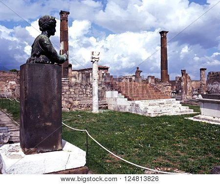 POMPEII, ITALY - SEPTEMBER 21, 1996 - View of the Temple of Apollo with a statue in the foreground Pompeii Campania Italy Europe, September 21, 1996.