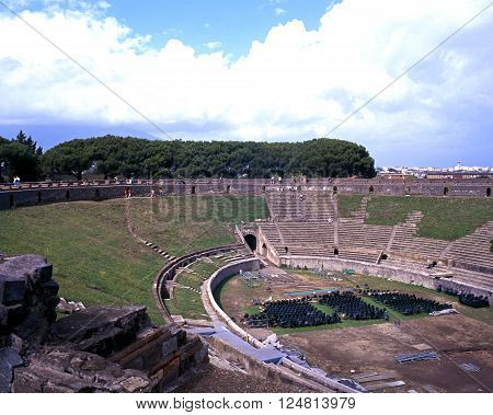 POMPEII, ITALY - SEPTEMBER 21, 1996 - Elevated view of the Roman Theatre ruin with modern buildings to the rear Pompeii Campania Italy Europe, September 21, 1996.