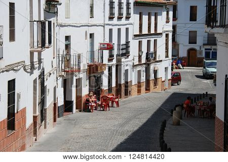 ALORA, SPAIN - JUNE 27, 2008 - People relaxing at bars along a town street Alora Malaga Province Andalusia Spain Western Europe, June 27, 2008.