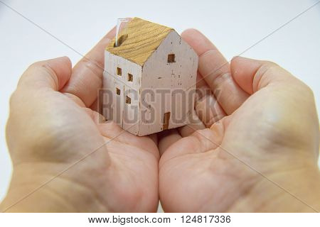 White house in hands Model of house , Buy house, Start a family, Home loans