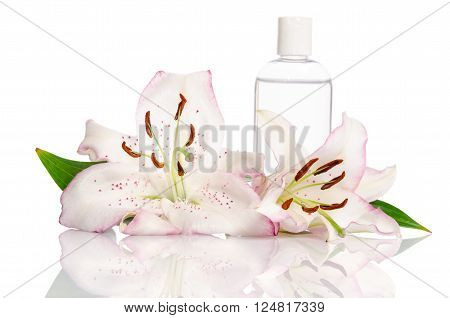 tonic for skin care with lily flowers on a white background