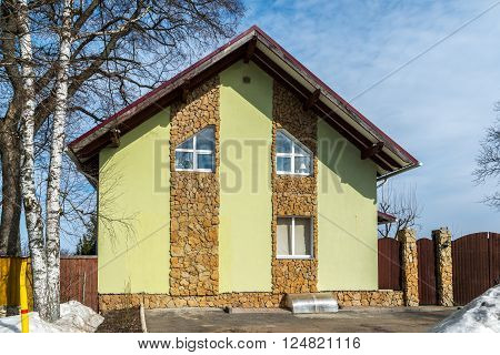 A standard two-storey cottage Finished decorative stone