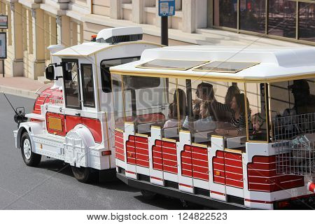 Monte-Carlo, Monaco - April 6, 2016: Red and White Trackless Train for Sightseeing in Monaco on the Street of Monte-Carlo, Monaco in the south of France