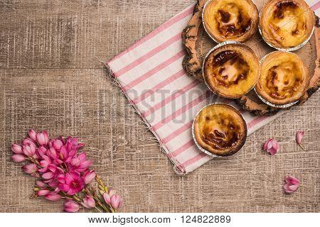 Pasteis de nata, typical Portuguese egg tart pastries on a set table
