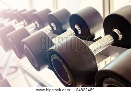 Close up row of dumbbells in modern sports club Vintage tone