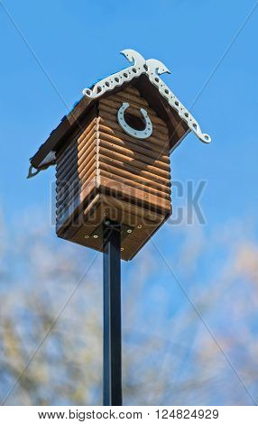 Nesting box. Carved wooden nest box handmade. Wooden house for birds on the tree.