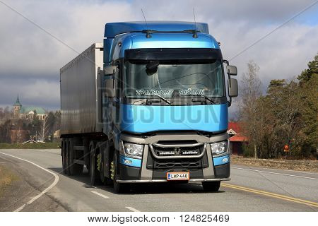 SALO, FINLAND - MARCH 27, 2016: Blue Renault Trucks T Semi on the road with a view to Salo in the background.