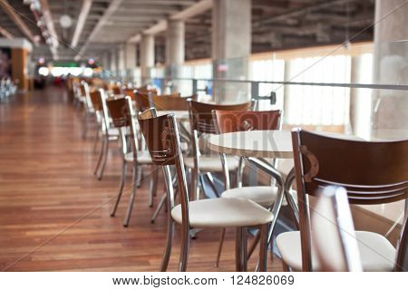 Tables in cafe Airport with beutifull bokeh.