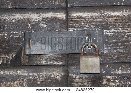 a door bolted with an old padlock