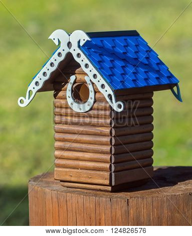 Nesting box. Carved wooden nest box handmade. Wooden house for birds