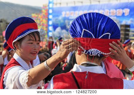 Heqing, China - March 15, 2016: Chinese Women In Ancient Bai Clothing During The Heqing Qifeng Pear