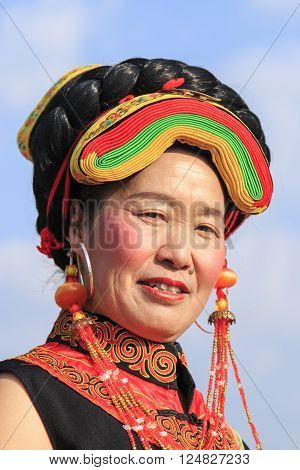 Heqing, China - March 15, 2016: Chinese Girl In Traditional Miao Clothing During The Heqing Qifeng P