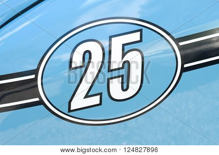 competition race number 25 on a light blue metallic panel
