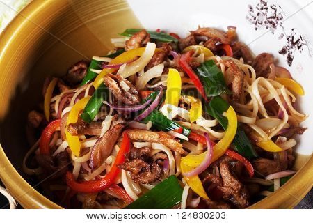 wok with beef noodles and vegetables close up bowl with  Chinese food