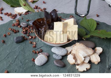 tree fungus, shiitake mushrooms, tofu ingredients on the stone table Chinese food atmosphere natural forests of the world