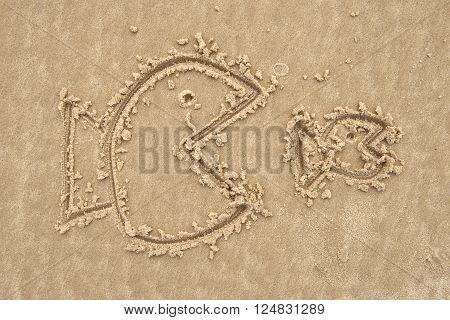 big fish eat small fish on sand