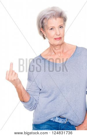 Senior woman gives someone the bird in front of white background