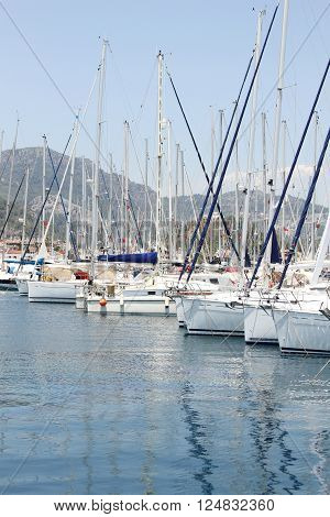 Many boats moored in the harbor. Marina in the Mediterranean