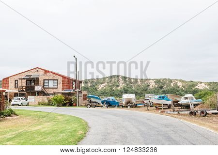 PORT ELIZABETH SOUTH AFRICA - FEBRUARY 26 2016: Rain is visible in a street scene at Cannonville in Colchester in the Eastern Cape Province of South Africa