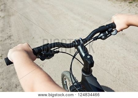 cycling with the speed. Focus on the handlebars.
