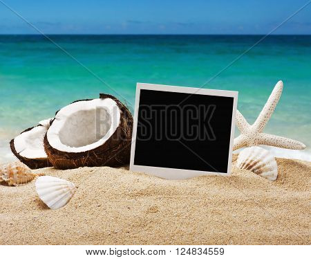 chopped coconut and photoframe on the sand