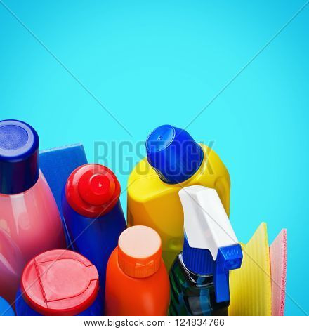 Cleaning supplies on blue background  rubber closeup