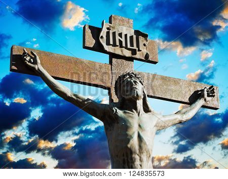 Crucifixion of Jesus Christ on a background cloudy sky