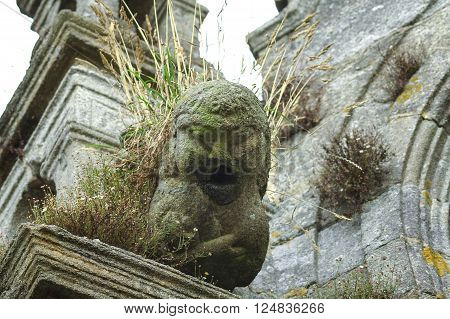 Lampaul-Guimiliau (Finistere Brittany France) gargoyle of the medieval church