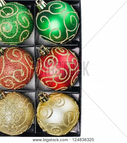 Multi Colored Christmas balls in a box with a place to write a congratulatory text
