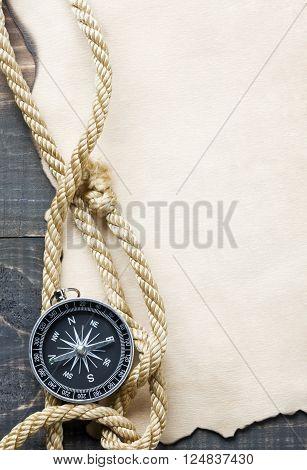Compass on vintage paper background direction revival
