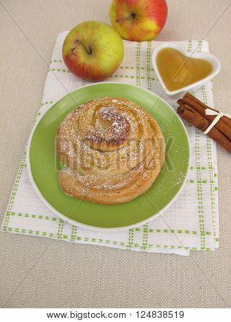 Homemade apple pinwheel with cinnamon and icing sugar
