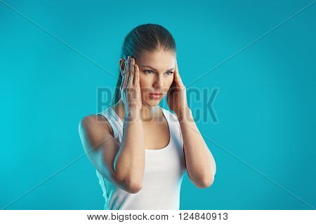 Depressed young woman having tinnitus and dizziness. Concept of stress, sickness and mind problem.