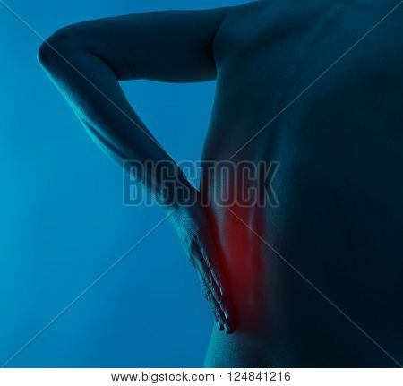 Back nerves. Spine pain on human body over blue background.