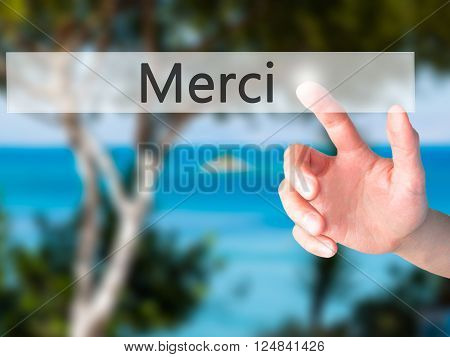 Merci - Hand Pressing A Button On Blurred Background Concept On Visual Screen.