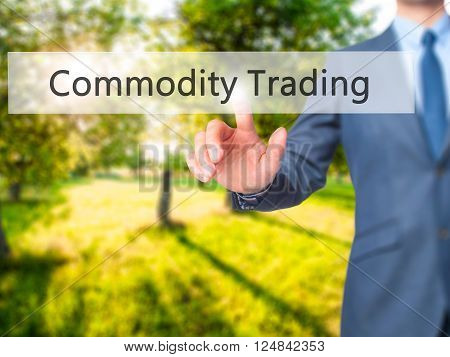Commodity Trading - Businessman Hand Pressing Button On Touch Screen Interface.