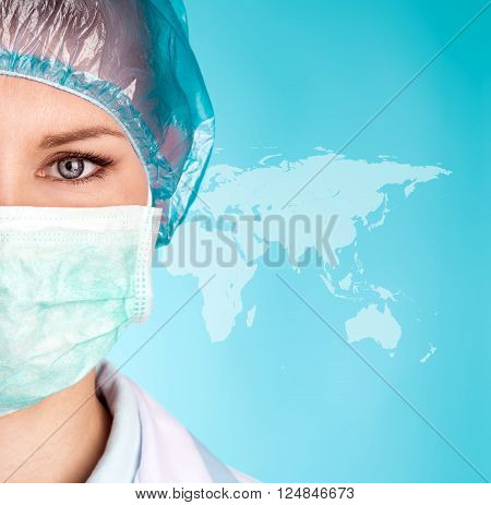 Beautiful woman doctor in surgical uniform over world map