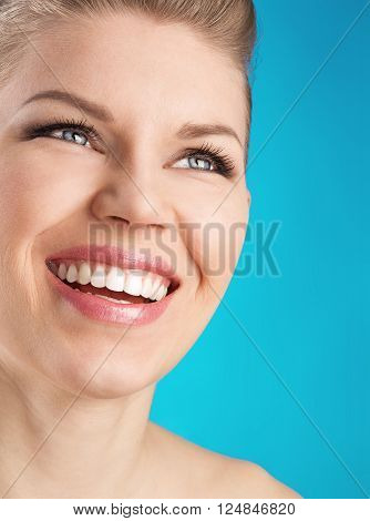 Happy smiling woman with white teeth with space for text