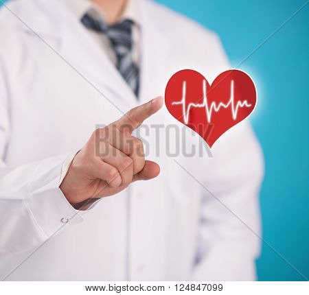 Doctor cardiologist pointig at heart symbol over blue